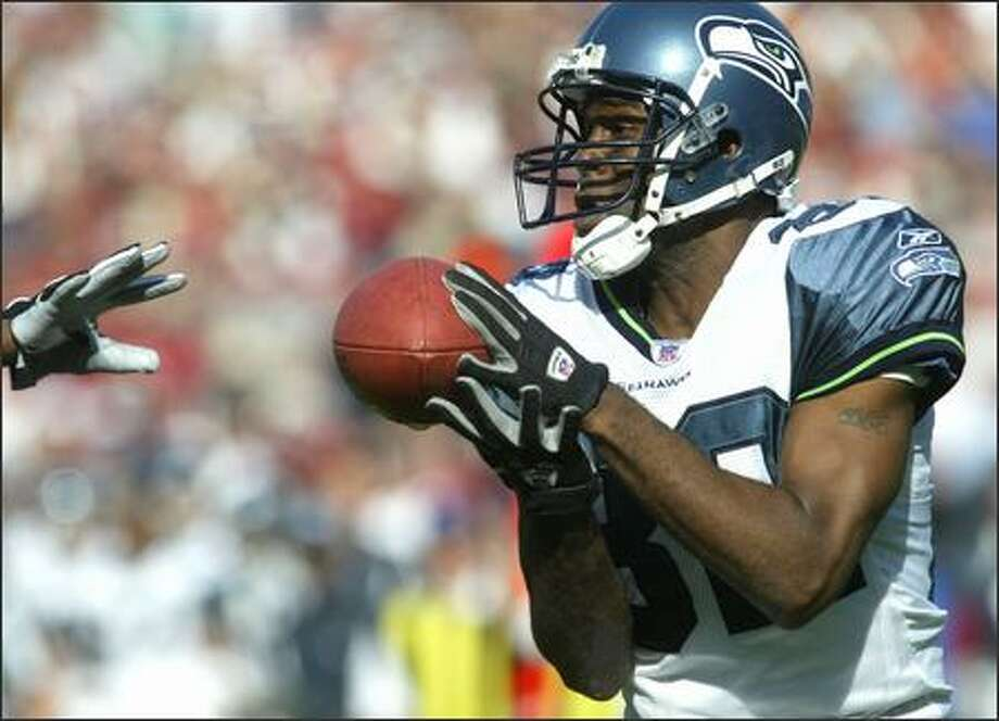Seahawks wide receiver Darrell Jackson hauls in a touchdown catch against the 49ers during first-quarter play at Monster Park in San Francisco.The Seahawks won 42-27. Photo: Dan DeLong, Seattle Post-Intelligencer / Seattle Post-Intelligencer