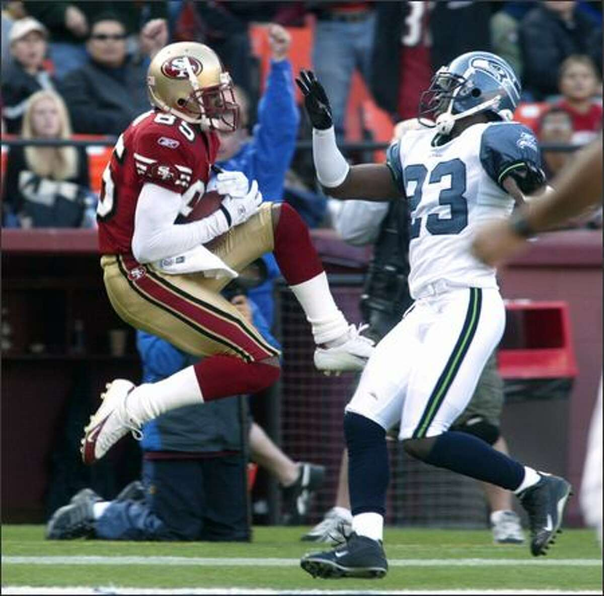 Seahawks cornerback Marcus Trufant is unable to stop 49ers receiver Brandon Lloyd from pulling in a touchdown reception in the third quarter.
