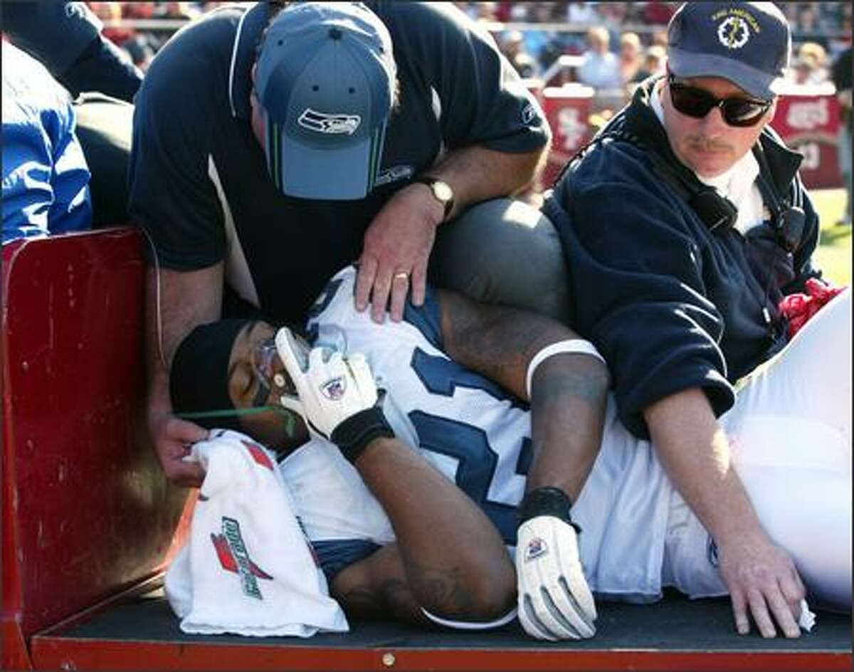 Seahawks cornerback Ken Lucas is carted off the field after getting injured.