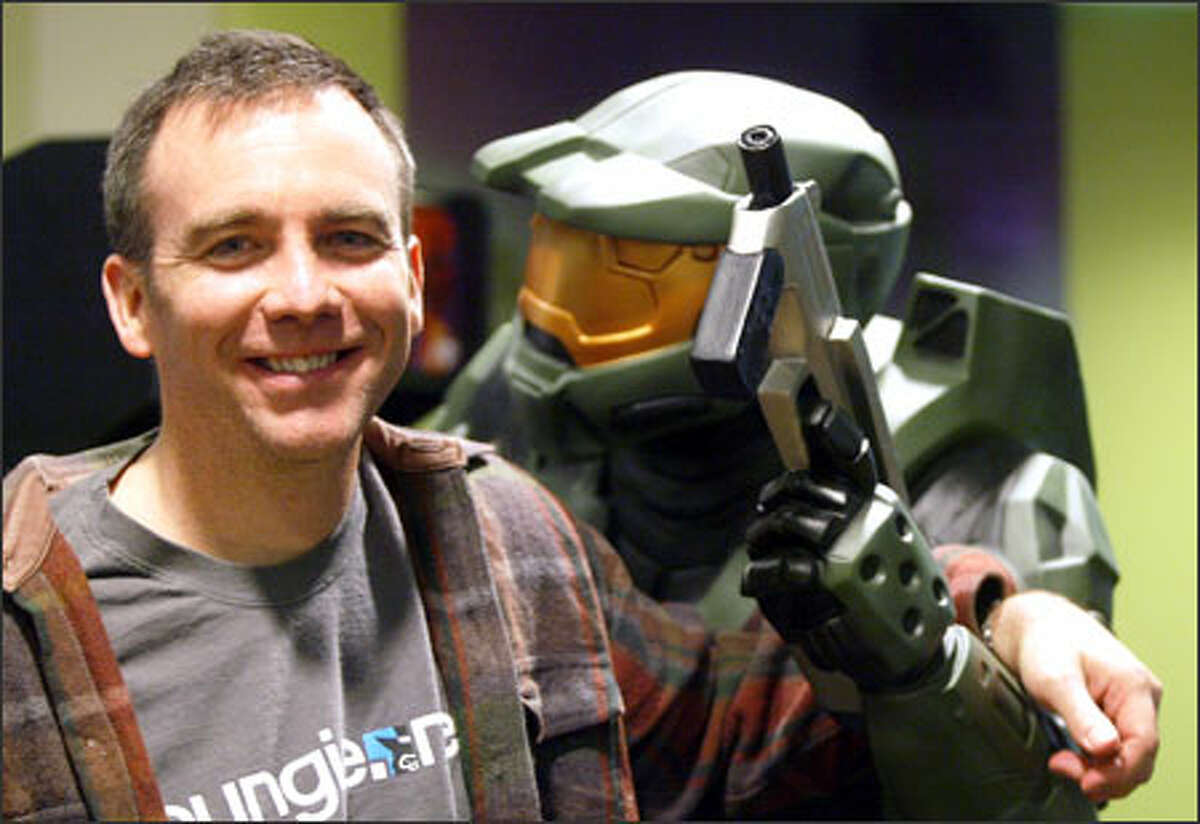 Pete Parsons, Bungie Studios manager and executive producer, hangs with a model of Halo protagonist Master Chief.