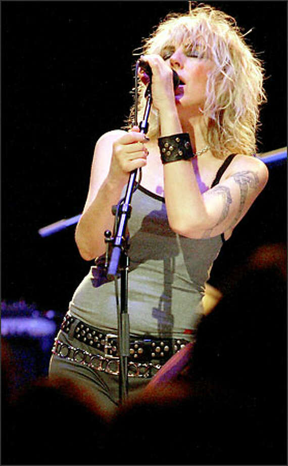 Lucinda Williams shows off her vocal skill and her tattoo in her show at The Moore on Sunday. Photo: Paul Joseph Brown, Seattle Post-Intelligencer / Seattle Post-Intelligencer