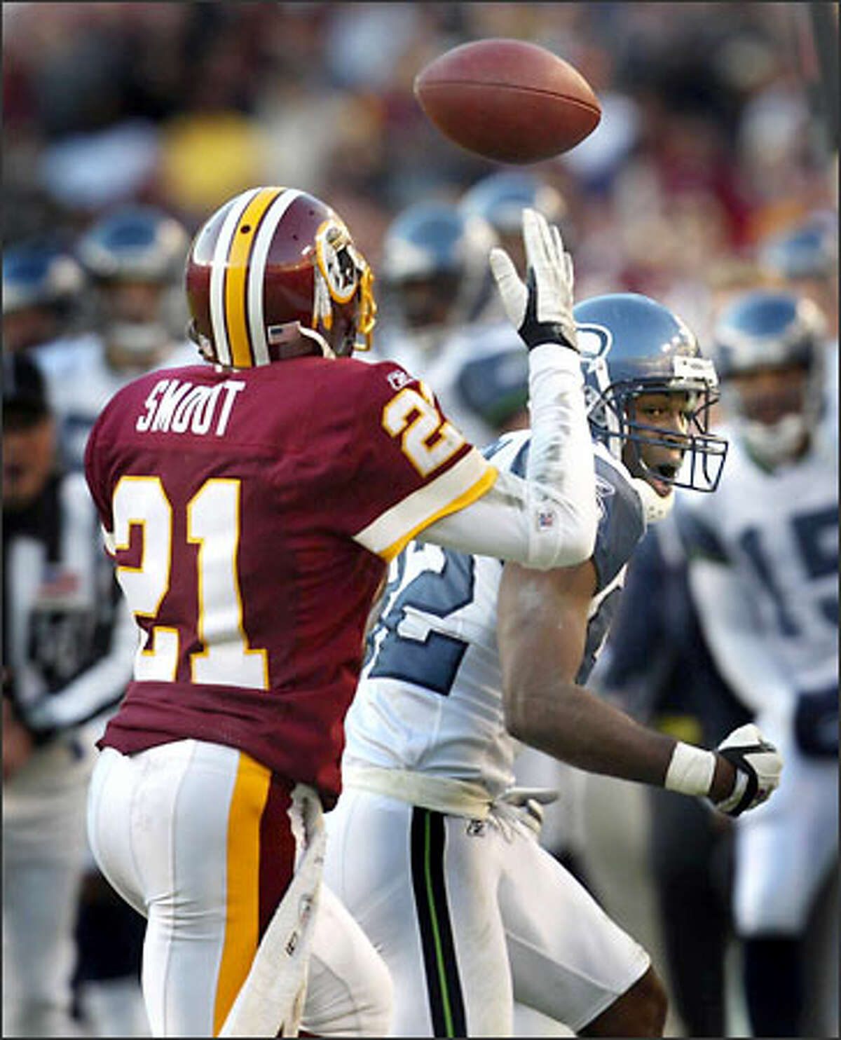 Seahawks' receiver Darrell Jackson reacts as the ball gets away from him in the final minute and finds the hands of Redskins' defensive back Fred Smoot for an interception to seal the Washington victory.