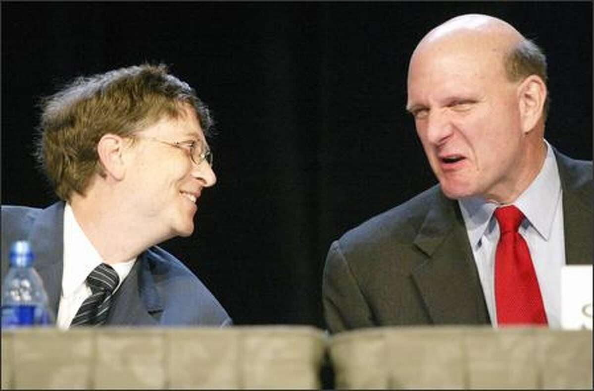 Microsoft's Bill Gates and Steve Ballmer appear at the company's annual shareholders meeting in Bellevue yesterday. Some in the audience had pointed questions about the stock's sluggish price.
