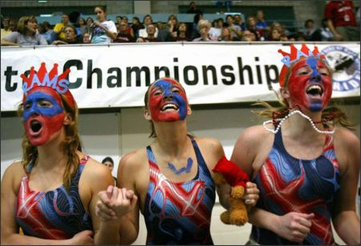 West Valley High School swimmers, from left, Natalie Day, Katie Hawkins and Caitlin Richardson cheer on teammates at the King County Aquatics Center in Federal Way during the WIAA/Dairy Farmers of Washington State Swimming Championships last Friday.