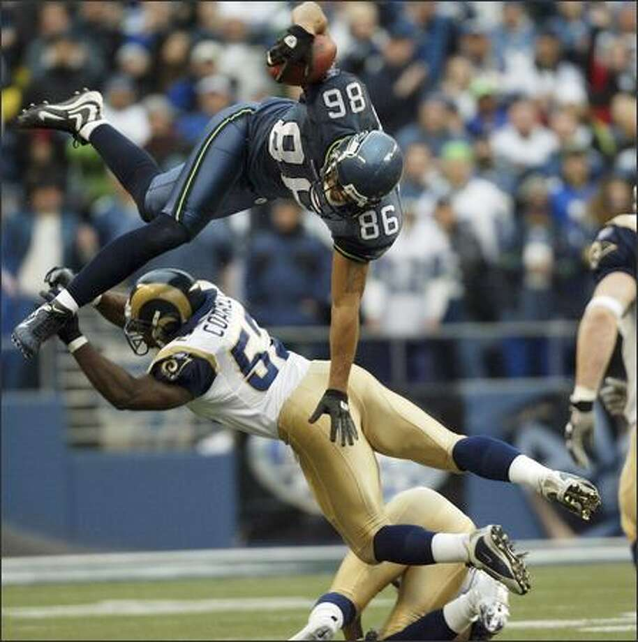 Seattle Seahawks' Jerramy Stevens leaps over St. Louis Rams Dexter Coakley during the second quarter of last Sunday's game at Qwest Field.  Seattle won 31-16. Photo: Mike Urban, Seattle Post-Intelligencer / Seattle Post-Intelligencer