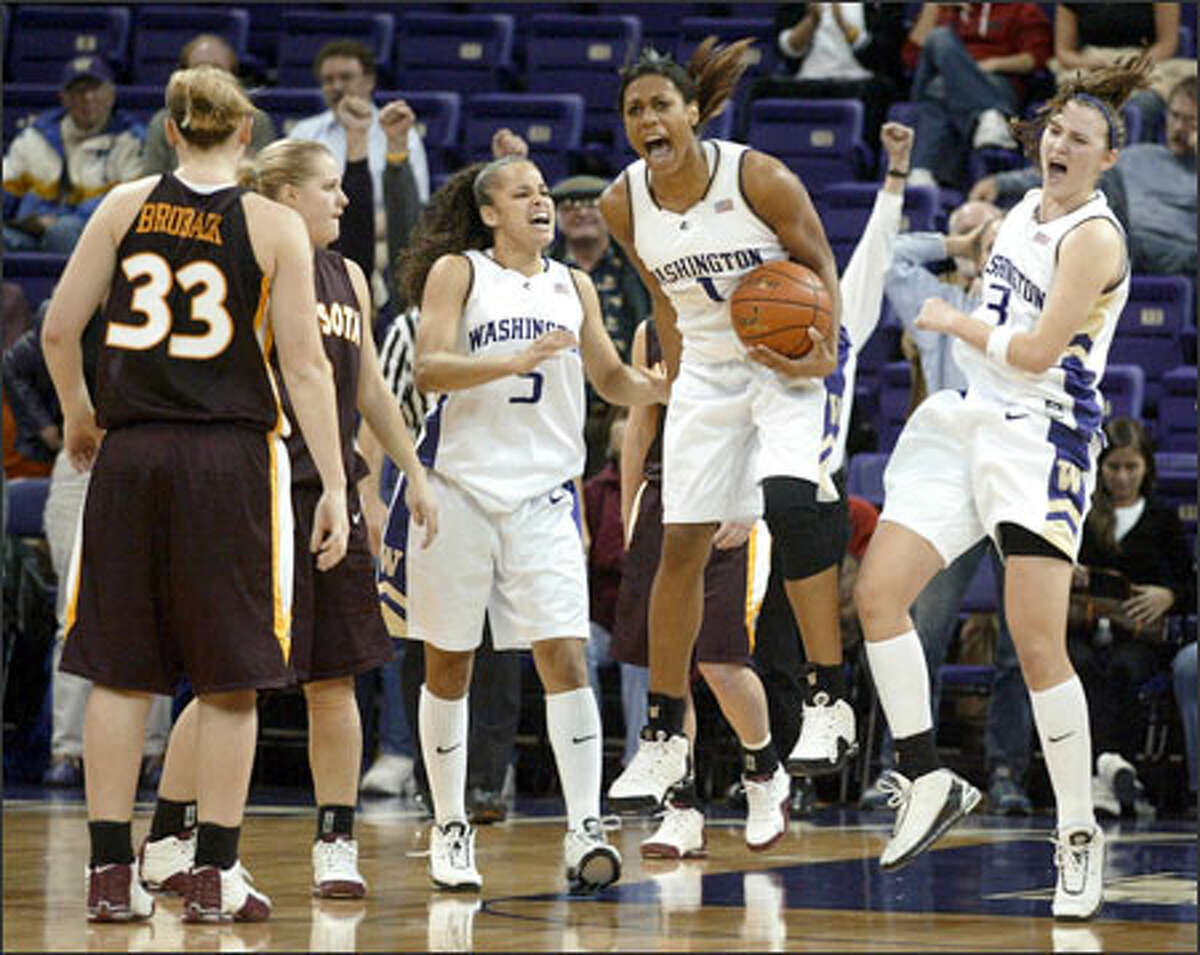 Washington's Jill Bell, center, Cameo Hicks, left, and Breanne Watson, right, celebrate grabbing the final rebound after Minnesota failed to convert a 3-pointer in the last seconds of overtime, giving the Huskies (2-0) a 72-67 win over the No. 14-ranked Gophers in the championship game of the WBCA/BTI Classic at Hec Edmundson Pavilion.