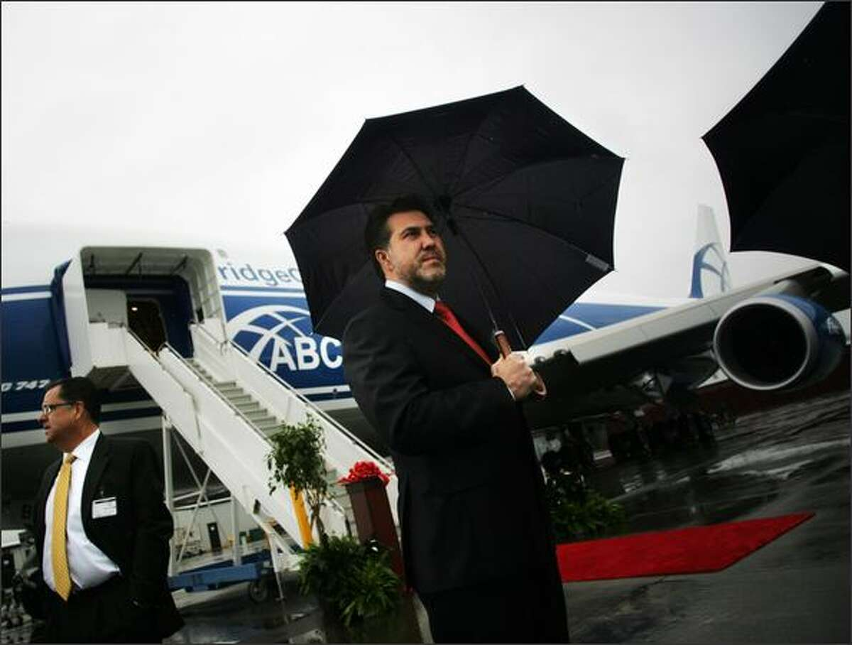 AirBridge Cargo Vice President of production and engineering Gennady Pivovarov stands in front of his company's new Boeing 747-400 Freighter before a ribbon cutting ceremony at Boeing in Everett. AirBridge is the first Russian operator to receive a Boeing jet directly from the Everett factory.