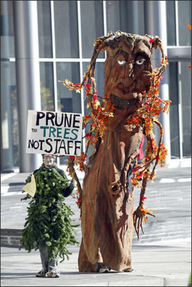 "About 15 demonstrators, including Shelley Retchless, left, of Seattle and ""Marla the Maple,"" also of Seattle, rallied at Seattle City Hall to protest cuts in the care of city street trees. Photo: Scott Eklund, Seattle Post-Intelligencer / Seattle Post-Intelligencer"
