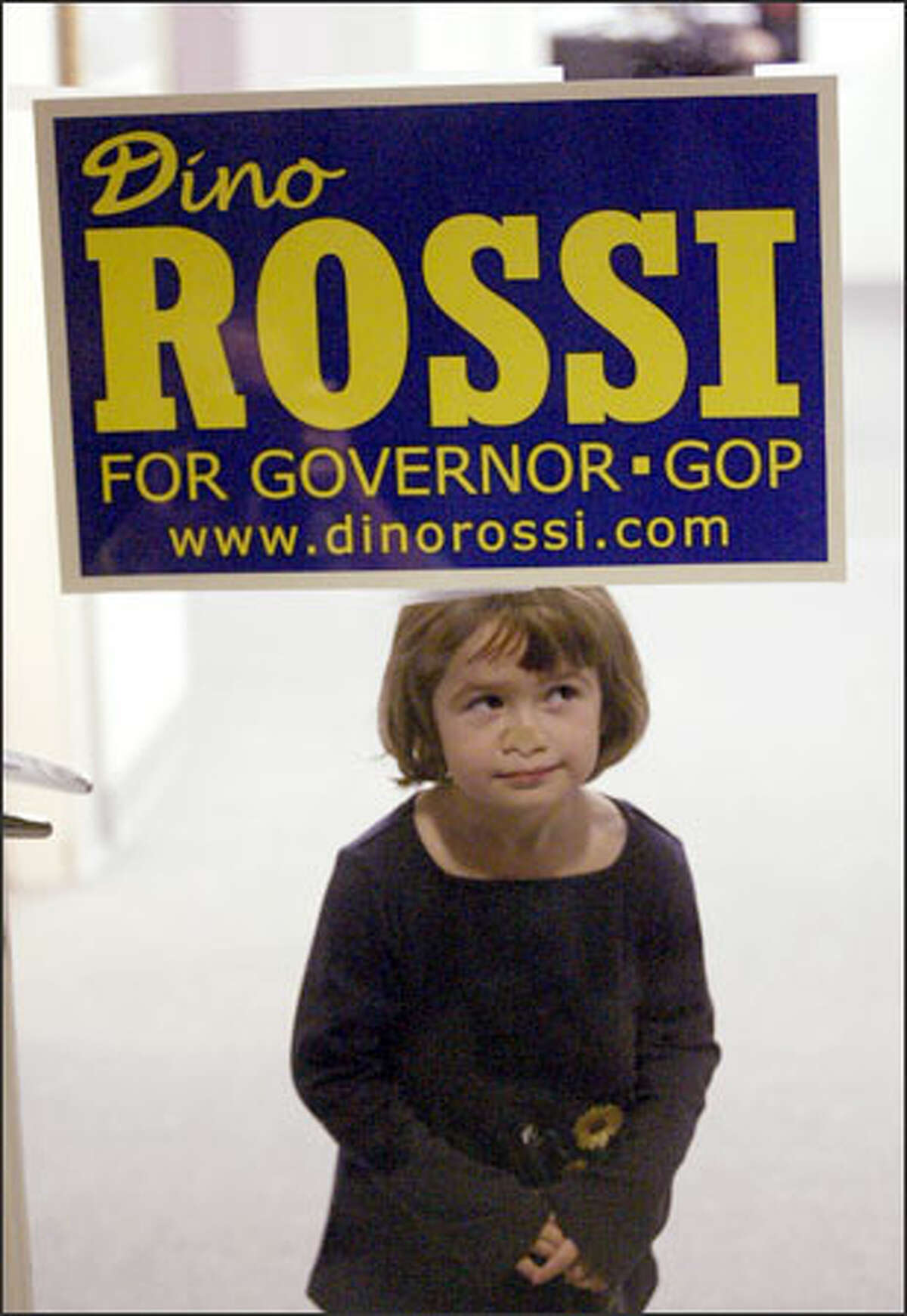 Jillian Rossi, playing at the headquarters of her father, Republican gubernatorial candidate Dino Rossi, appears to say he won by a nose. In the final tally, Rossi led by 261 votes -- but the narrow margin of victory mandates a recount under state law.