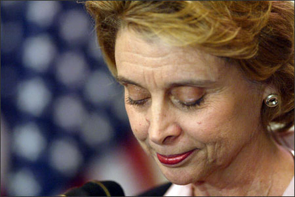 """Christine Gregoire meets reporters last night for the first time since the Nov. 2 election. """"This race is far from over,"""" she said. """"And we're in it for the long haul."""""""