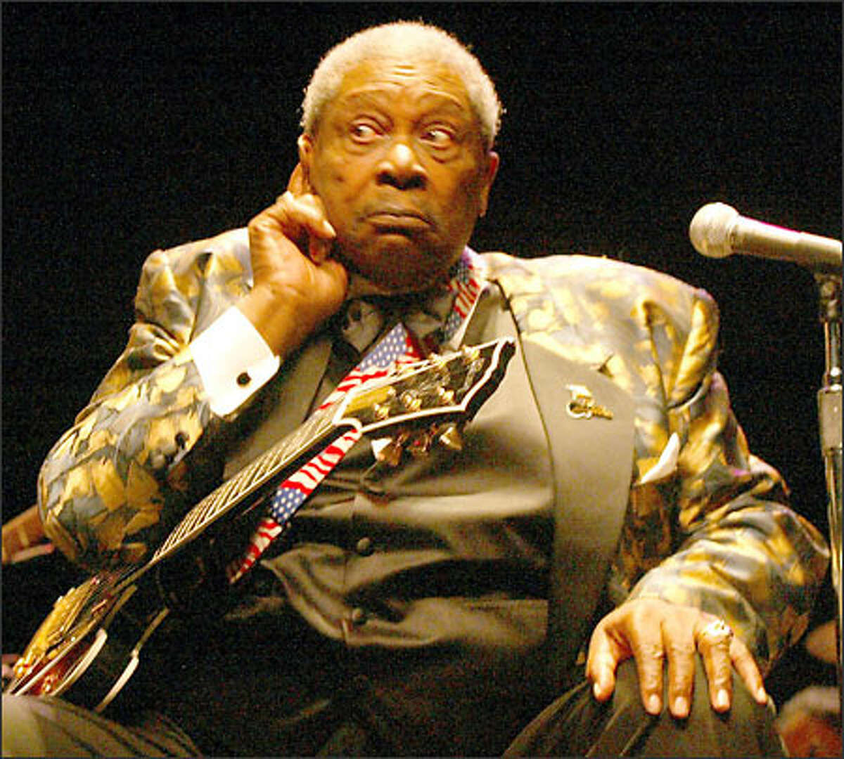 B.B. King, the Mississippi-bred blues legend, pretends he can't hear a lady who yells out