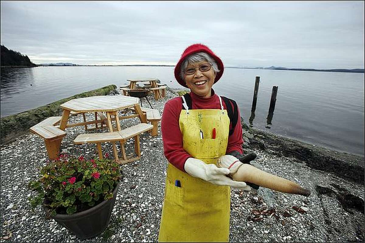 Teresa Sheppler has worked at Taylor Shellfish's Samish Bay Farm and Store since 1980. She is photographed making friends with a goeduck.