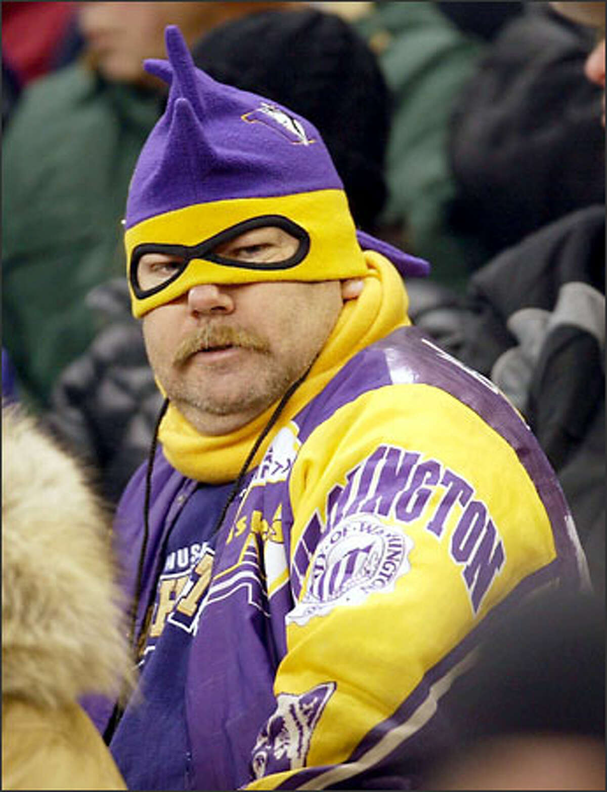 A UW fan shows his support at the Apple Cup.
