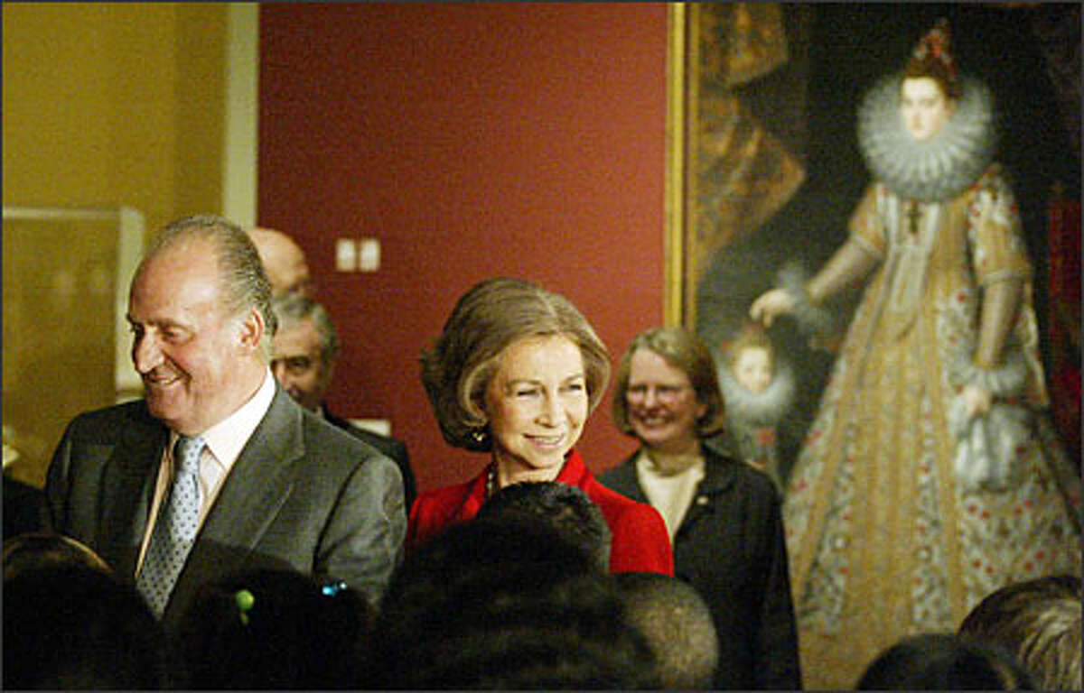 """King Juan Carlos and Queen Sofia of Spain chat with Seattle students during their visit Monday to the Seattle Art Museum's exhibit """"Spain in the Age of Exploration, 1492-1819."""" The exhibit, culled mainly from Spain's royal collections, will be on display until Jan. 2. The royal couple shared their tour of the exhibit with a group of fifth-graders."""