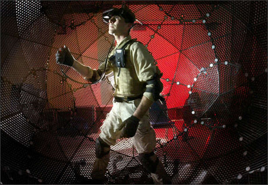 Kaizen Taki demonstrates how VirtuSphere simulates the action of walking at the University of Washington's Human Interaction Technology lab in Seattle. Photo: Joshua Trujillo, Seattlepi.com / Seattle Post-Intelligencer