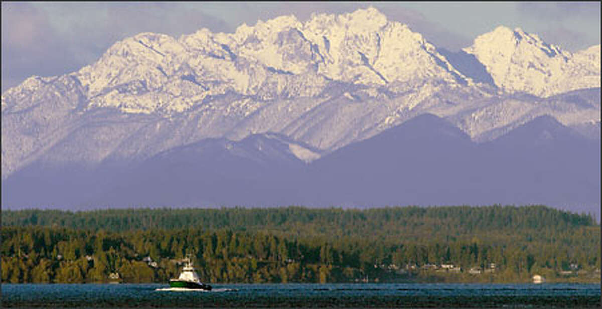 The Olympic Mountains give a grand exposure of their recent snowfall.