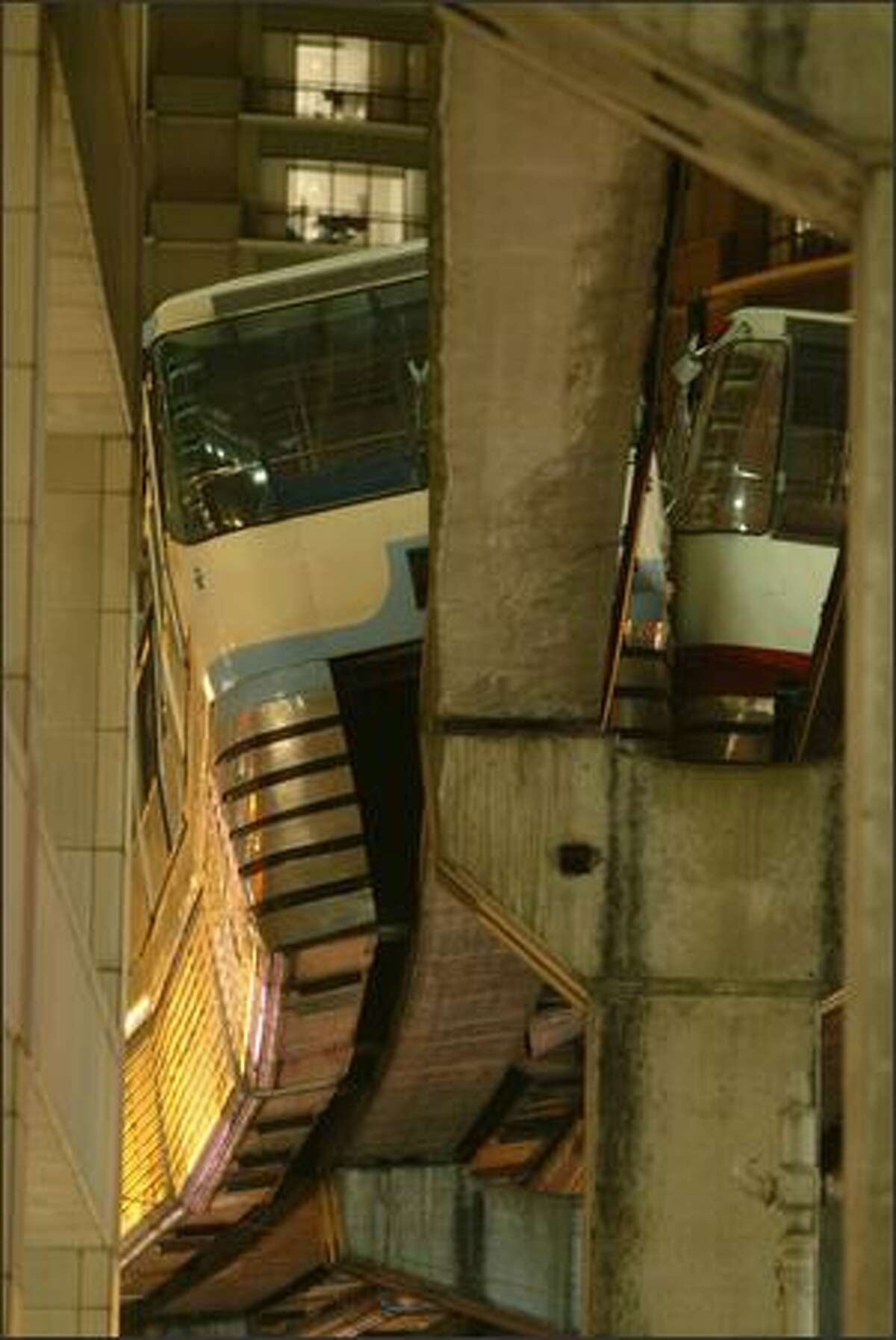 Firefighters had to evacuate Seattle's two monorail trains after they clipped each other Saturday night near Westlake Center, where the track narrows. Bystanders said it appeared one train was going to fall to the ground, and passengers all moved to one side of the train. Glass rained down on the sidewalk below.