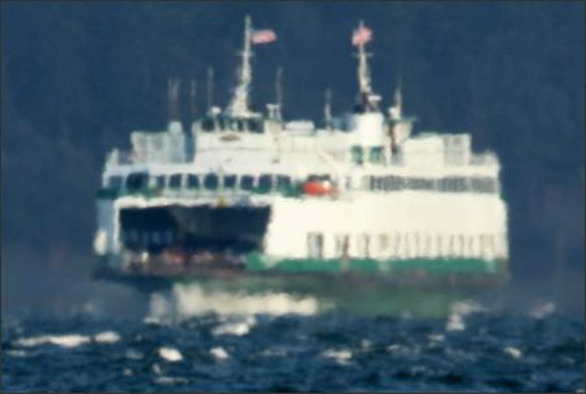 If French impressionist painter Claude Monet had ferry boats to paint instead of water lilies they might have turned out looking like this. The Washington State Ferry Tillikum appears distorted as it plies the 51-degree waters. A blanket of warm air rising off the water causes the light reflecting off the ferry to distort much like distant objects seen across the hot sands of an arid desert.