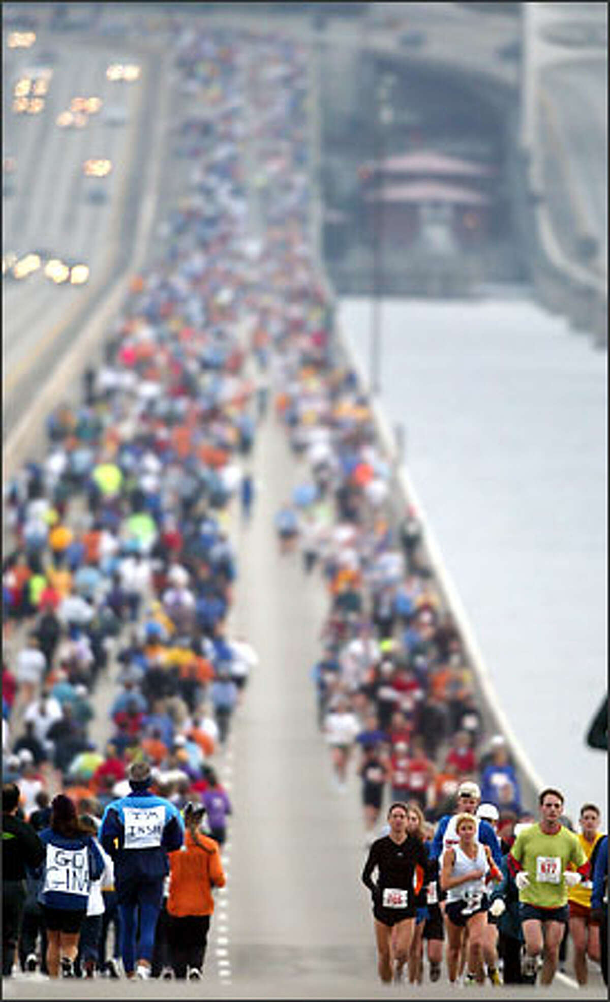 Runners make their way across the Interstate 90 bridge during the Seattle Marathon. More than 3,000 people participated in the 26.2-mile run, following a route from downtown Seattle to Mercer Island and back, then south on Lake Washington Boulevard, around Seward Park to Boylston Avenue East before heading for the finish at the Seattle Center.