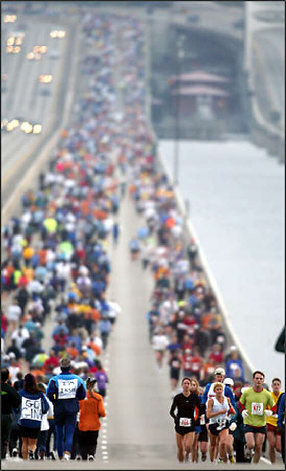 Runners make their way across the Interstate 90 bridge during the Seattle Marathon. More than 3,000 people participated in the 26.2-mile run, following a route from downtown Seattle to Mercer Island and back, then south on Lake Washington Boulevard, around Seward Park to Boylston Avenue East before heading for the finish at the Seattle Center. Photo: Karen Ducey, Seattle Post-Intelligencer / Seattle Post-Intelligencer