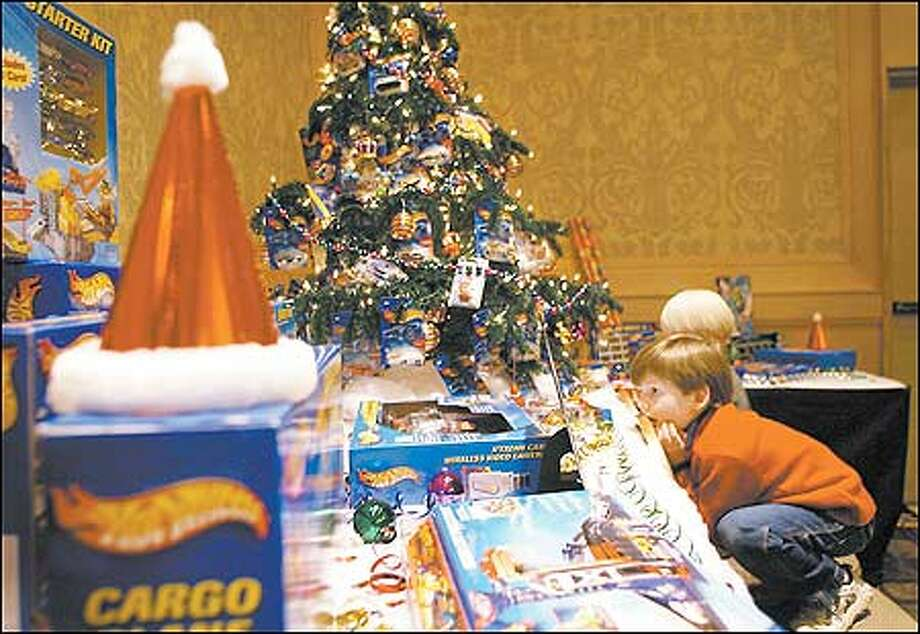 "Jack Brush admires the ""Hot Wheels Dreams"" display designed by Philip Sternola during the O'Christmas Trees preview event on Monday  at the downtown Westin Seattle. During the Public ""Treeview,"" people enjoyed hot cocoa and cookies as they viewed 20 elegently designed Christmas trees to be auctioned during the O' Christmas Trees Gala Dinner and Auction. Photo: Joshua Trujillo, Seattlepi.com / seattlepi.com"