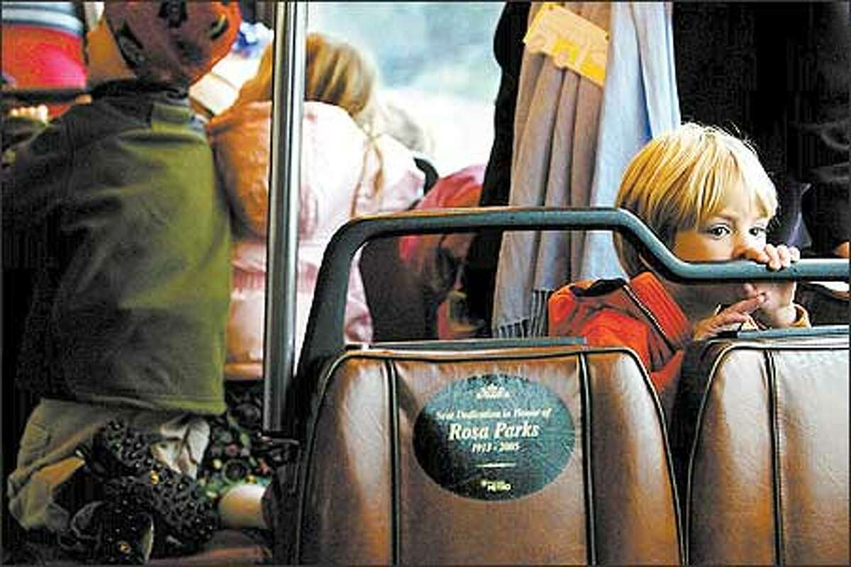 After a visit to the downtown library, Max Sorenson, a preschooler from St. Marks's Episcopal Cathedral, takes the bus back to school, along with other kids from his class.