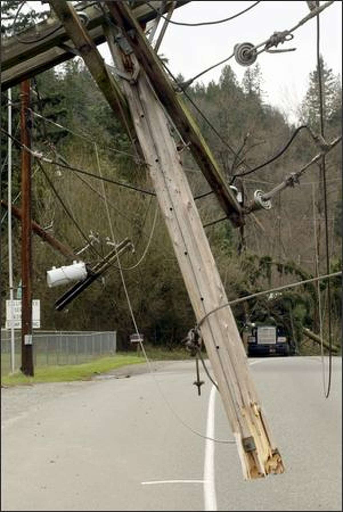 The tops of two utility poles were ripped off on Renton Maple Valley Road during a strong windstorm.