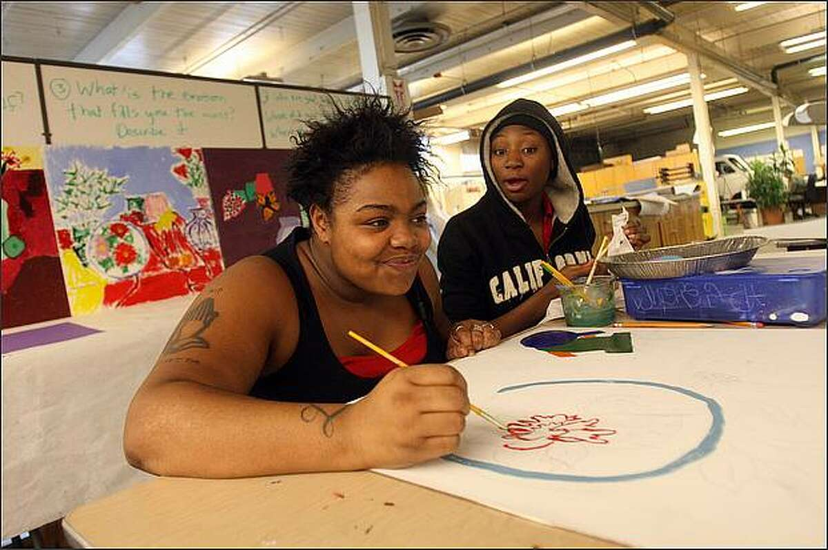 Lanisha Secrest, 17, left, and Briana Manson, 15, both of Seattle, work still-life paintings at Opportunity Skyway in South Seattle.