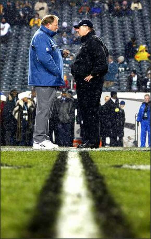Mike Holmgren and his former assistant Andy Reid, right, now Eagles head coach, meet before the game Monday in Philadelphia.  The Seahawks won 42-0. Photo: Scott Eklund, Seattle Post-Intelligencer / Seattle Post-Intelligencer