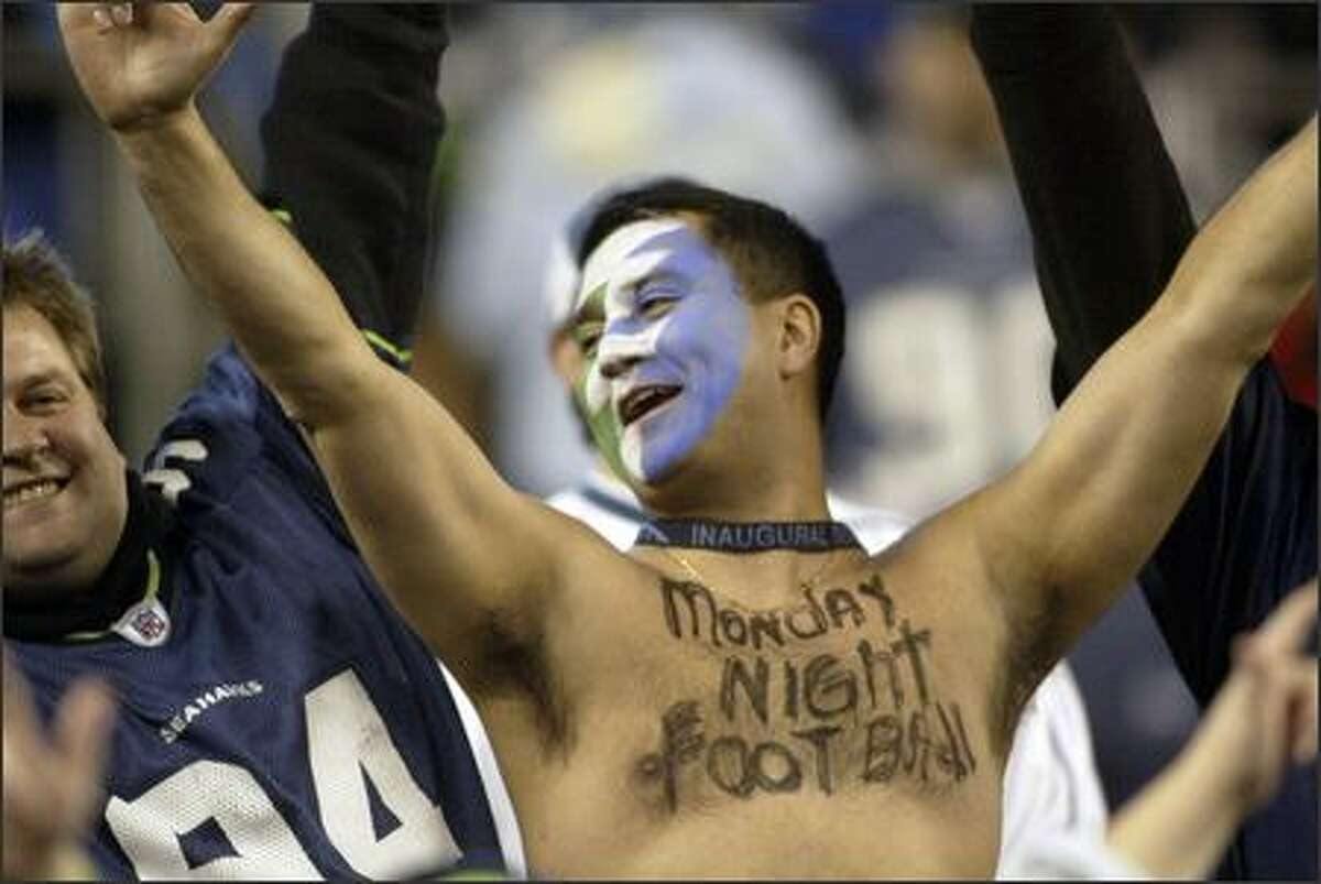"""With """"Monday Night Football"""" penned on his chest, a Seahawks fan shows his colors before the game at Qwest Field against the Dallas Cowboys."""