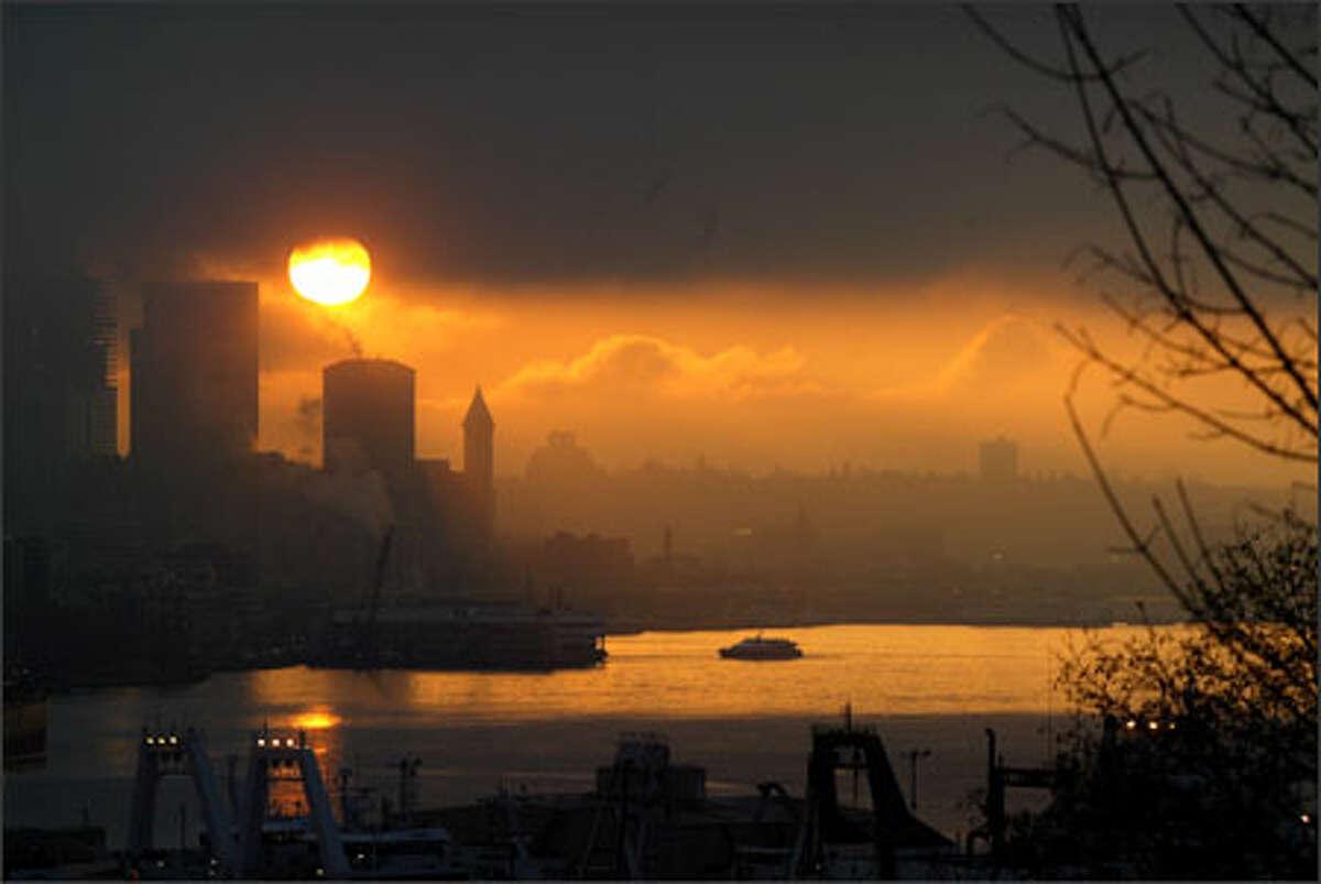 The sun rises over Seattle's Elliott Bay.