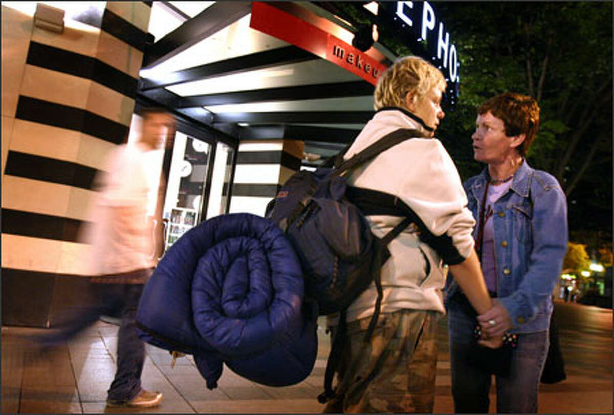 Eileen Corcoran of Street Outreach Services tries to persuade Becca, 18, to get clean after finding her wandering in downtown Seattle one night. Becca has worked Seattle's streets as a prostitute to support her drug habit since she was 17. After the pair argued, they made up with a hug.