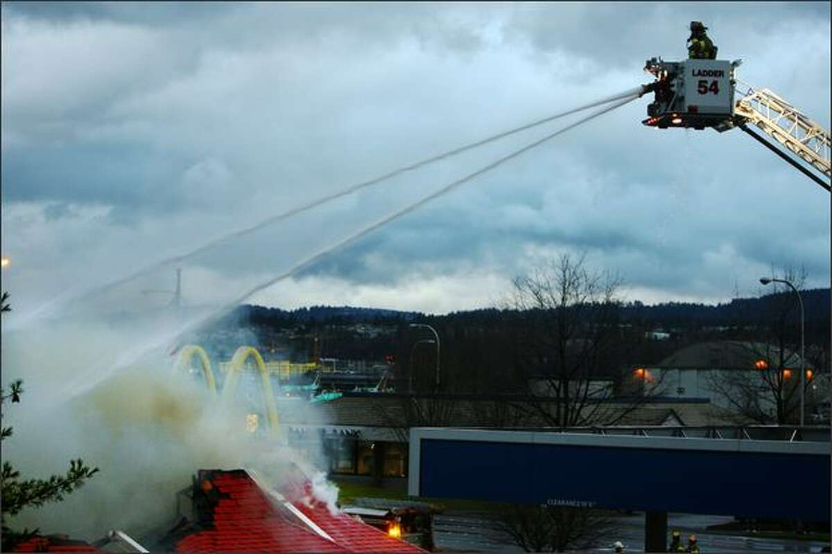 Firefighters battle a fire at the McDonalds on Rainier Avenue South and Airport Way in Renton.