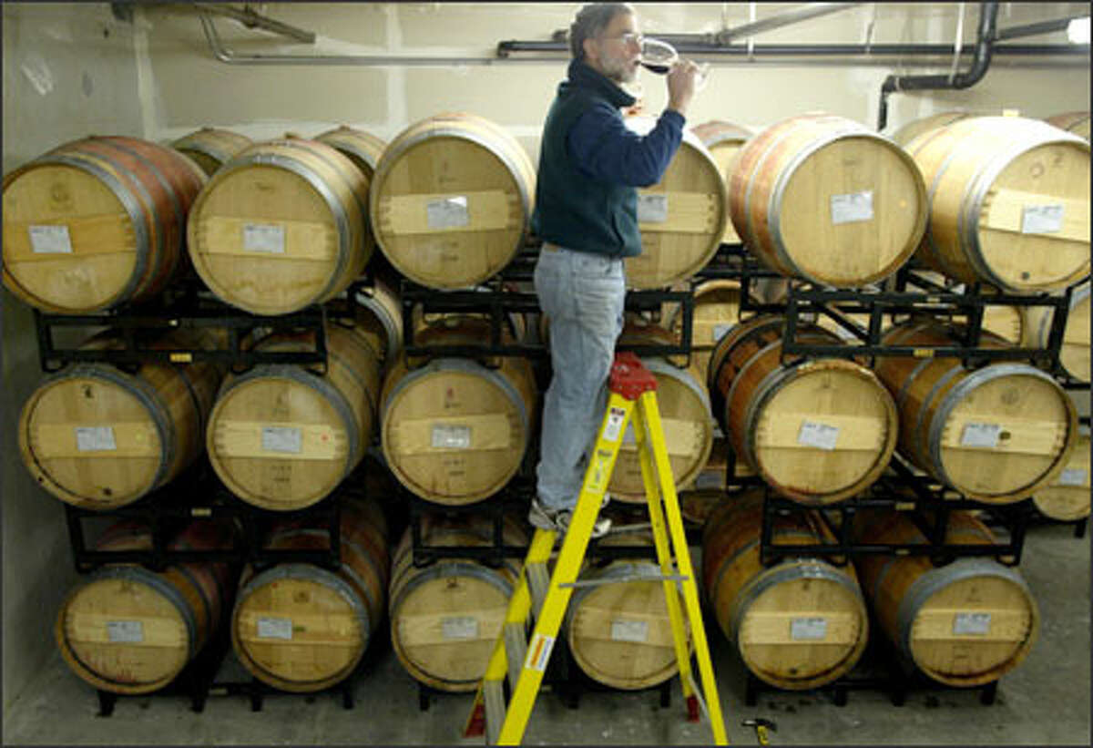 Bob Betz samples wine from oak barrels at Betz Family Winery in Woodinville yesterday. The winery would benefit if it could sell directly to out-of-state consumers.