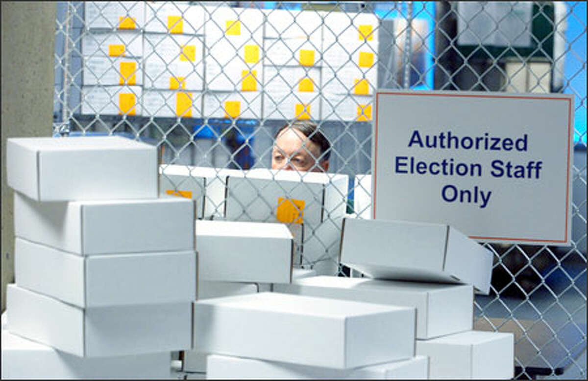 As a manual recount of ballots cast in the race for Washington state governor continues, Bob Rittenhouse, an employee of the King County Elections Department, catalogs sorted ballots in the gated area where the ballots are kept at a facility near Boeing Field.