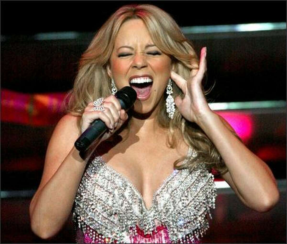 Mariah Carey, who has a five-octave range, hits a high note.