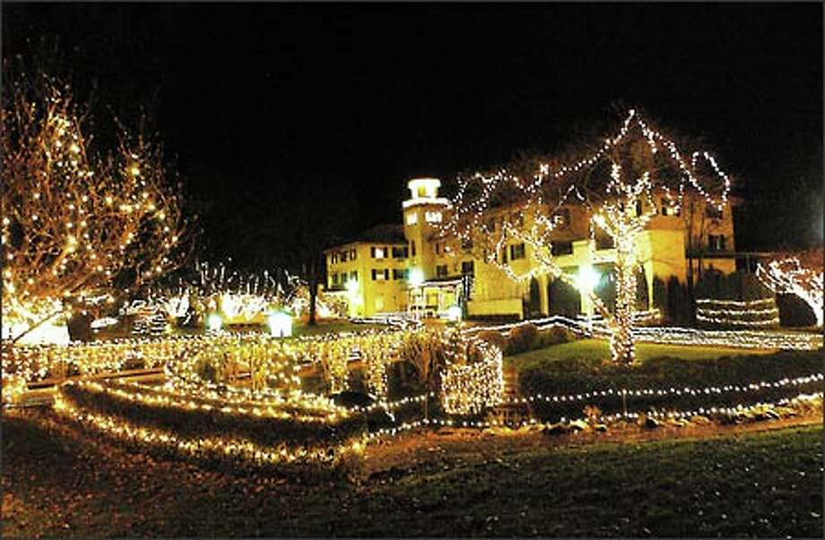 If you can take your eyes off the stunning view of the Columbia River, enjoy the hundreds of thousands of Christmas lights decorating the Columbia Gorge Hotel grounds in Hood River, Ore. Photo: Jeff Larsen, Seattle Post-Intelligencer / Seattle Post-Intelligencer