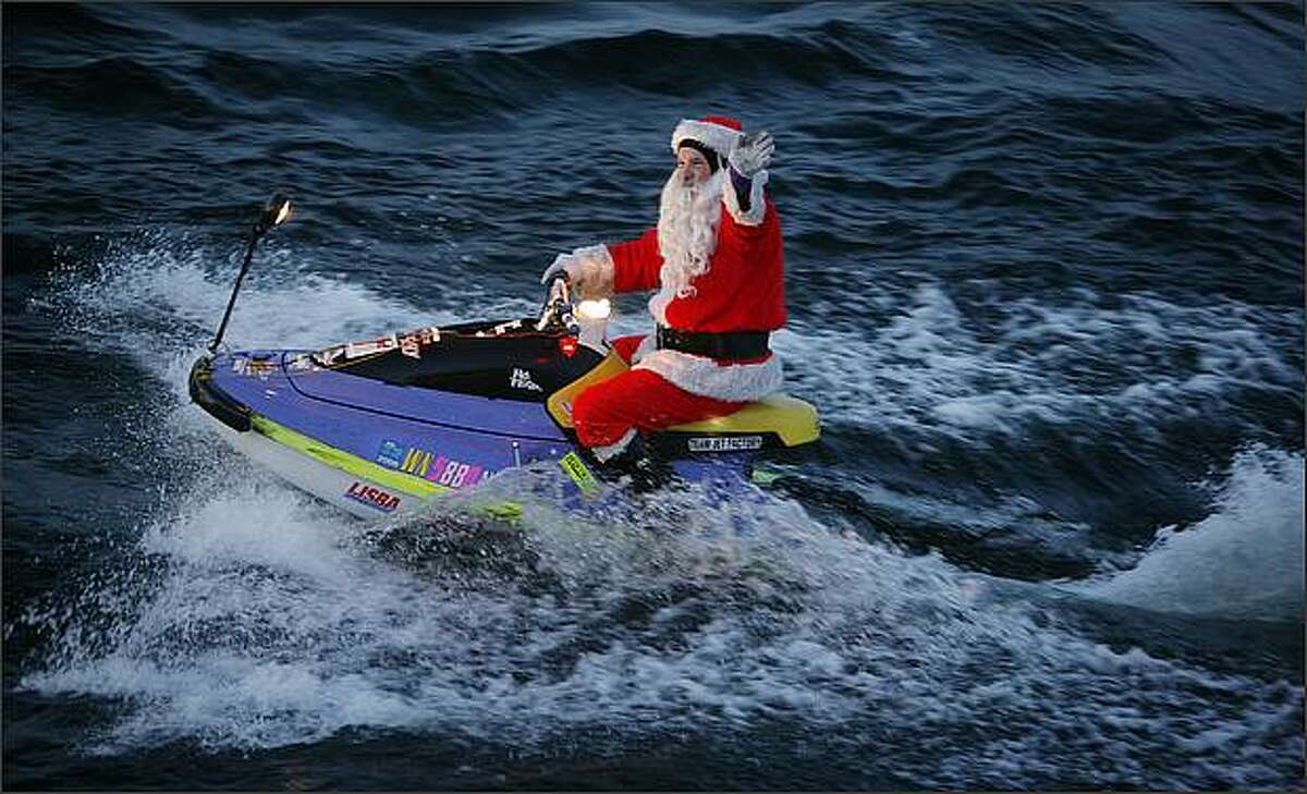 Santa on a jet ski greeted the Seafair annual Special People's Holiday Cruise as it entered Lake Washington.