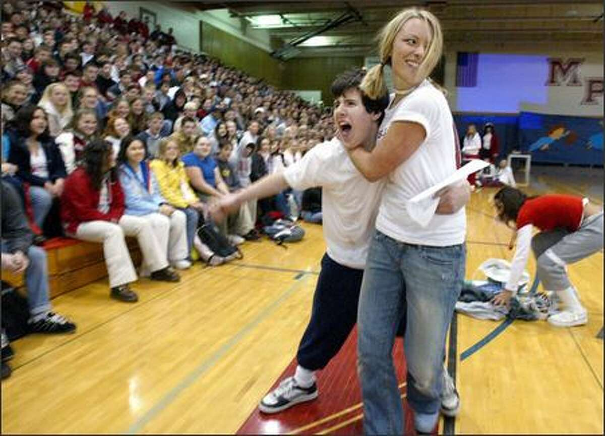 During a treasure hunt at the homecoming assembly, Jenna Hansen, homecoming queen at Marysville-Pilchuk High School, attempts to retrieve an item swiped from the seniors by freshman Joe Schober. Schober is the freshman class prince in the homecoming court.
