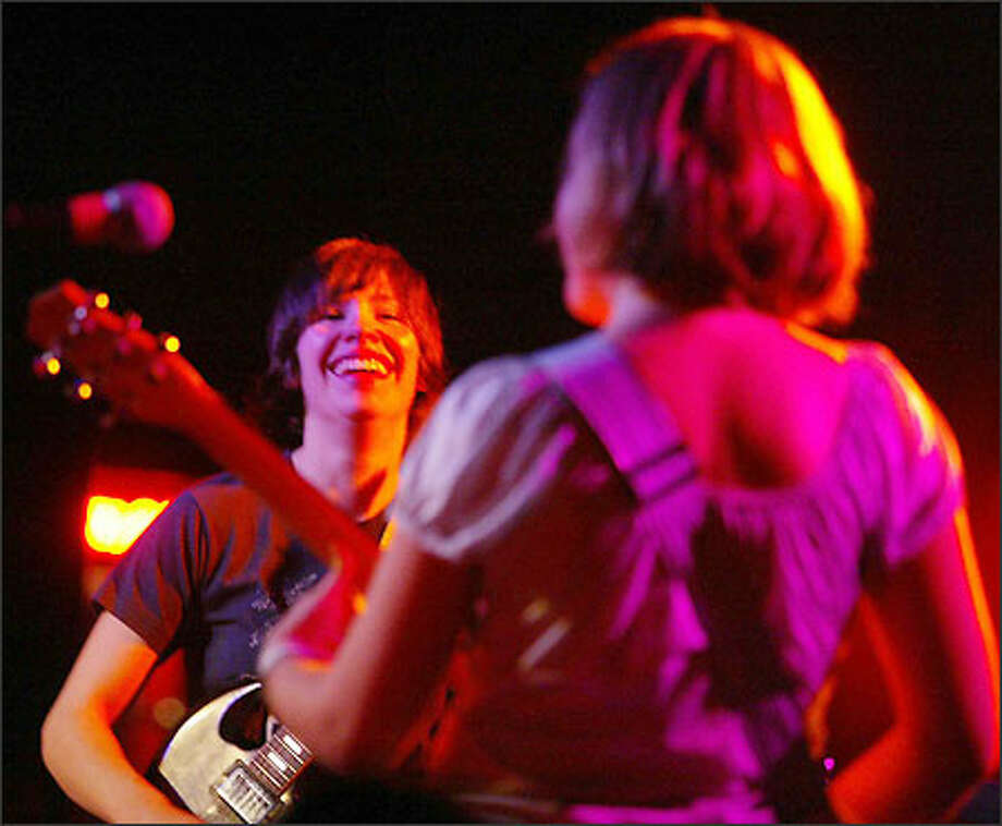 Olympia-based Sleater-Kinney guitarists Carrie Brownstein and Corin Tucker perform at The Showbox. Photo: Paul Joseph Brown, Seattle Post-Intelligencer / Seattle Post-Intelligencer