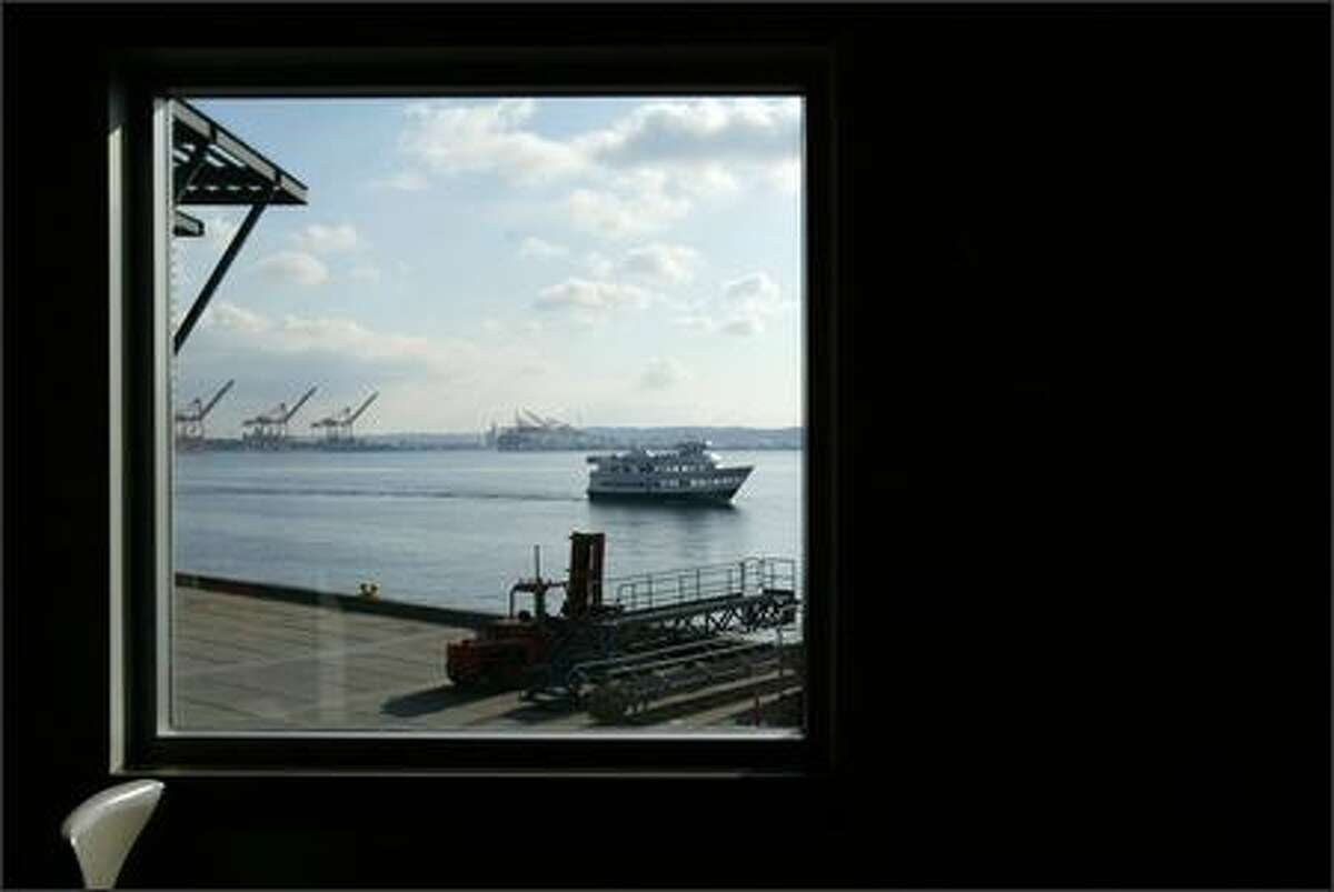 The view from the Bell Harbor International Conference Center and cruise ship terminal on Seattle's waterfront shows the dock used by ships, foreground, and Port of Seattle cranes, background.