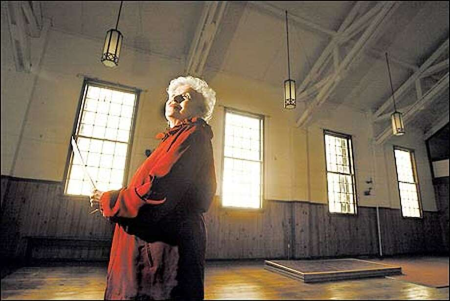 Heidi Carpine led an effort to save the small chapel at Discovery Park from being demolished. Except for the missing pulpit and pews, the building is intact. Photo: Scott Eklund, Seattle Post-Intelligencer / Seattle Post-Intelligencer