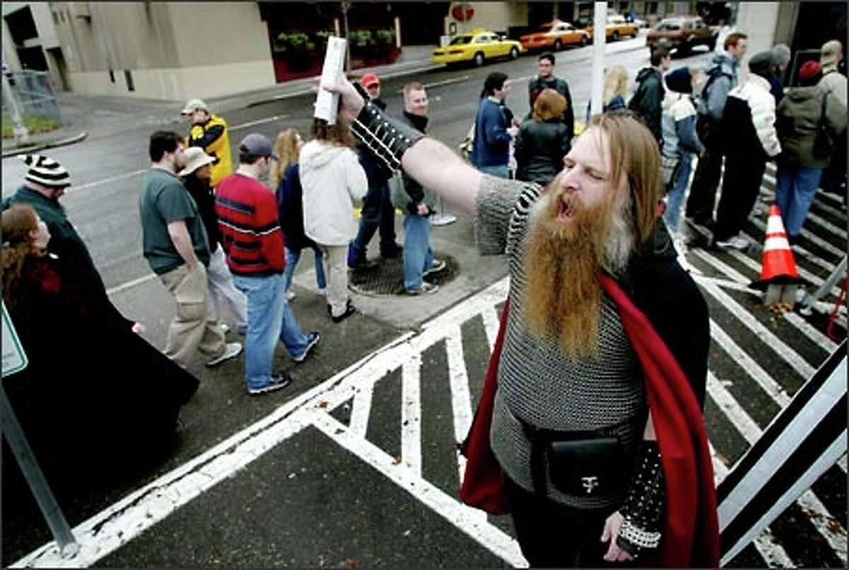 """""""Lord of the Rings"""" fan Paul Pfarr, dressed as a dwarf from the popular trilogy, shouts to fans as they wait in line to enter the Cinerama in downtown Seattle."""