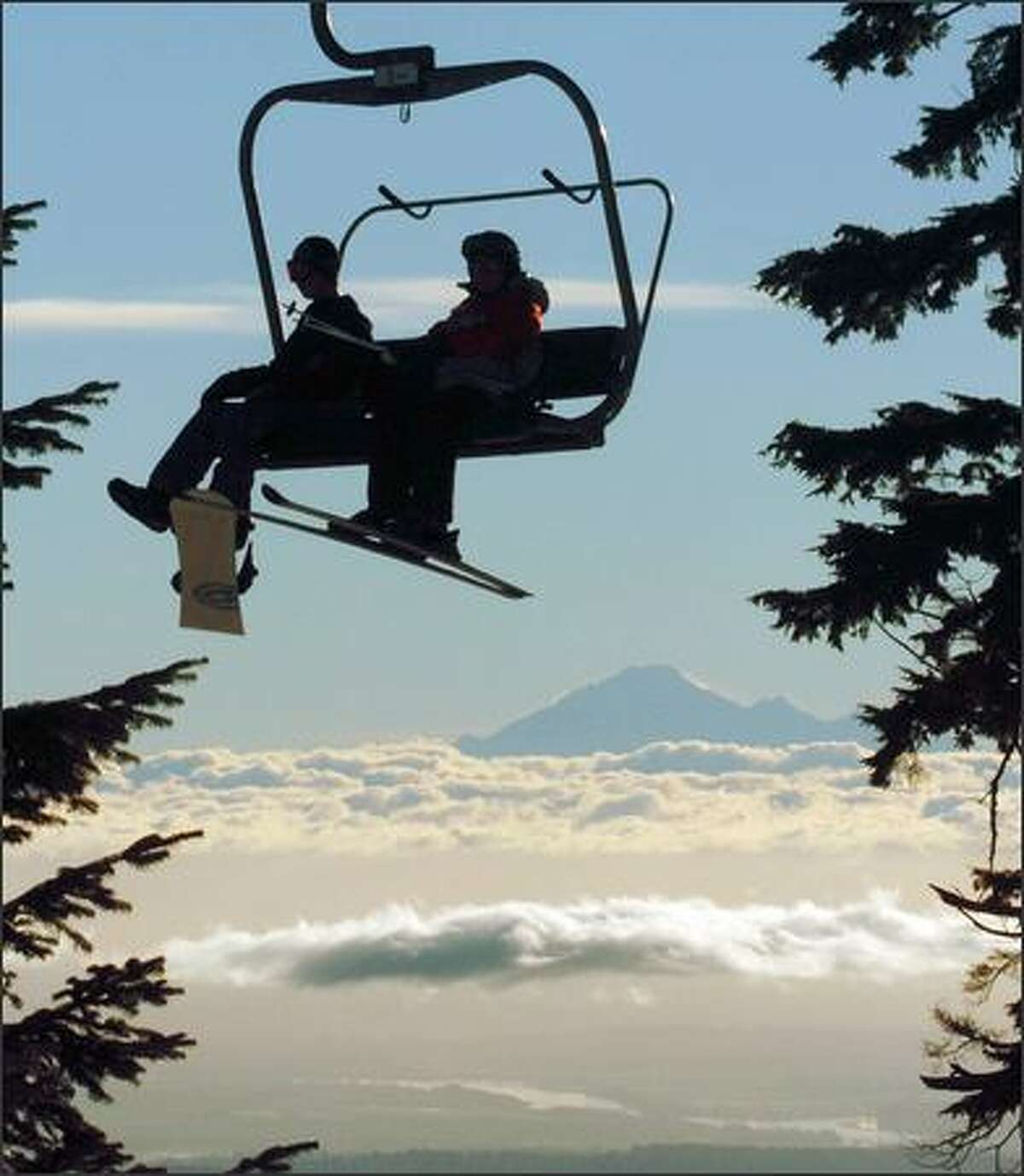 Early morning skiers at Grouse Mountain get a spectacular view of Mount Baker in Washington.