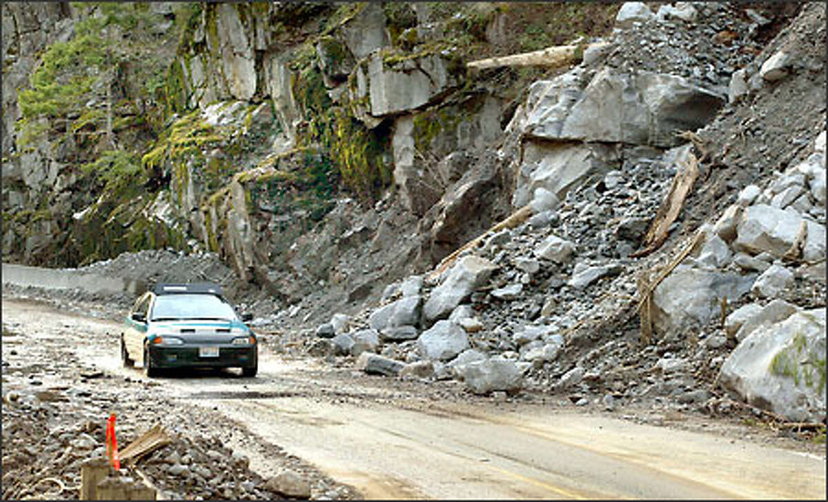 The North Cascades Highway, closed six weeks ago by a rockslide, is opening gradually, allowing access to and from homes for local residents and emergency workers.