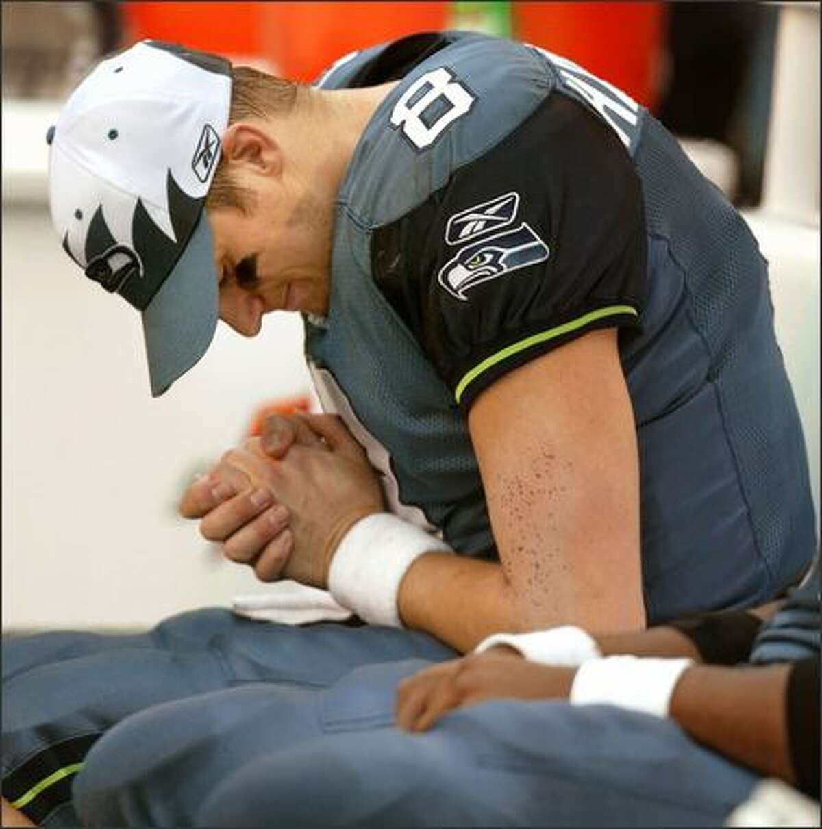 Seattle Seahawks Matt Hasselbeck holds his injured hand after walking off the field with 6:17 left in the second quarter.