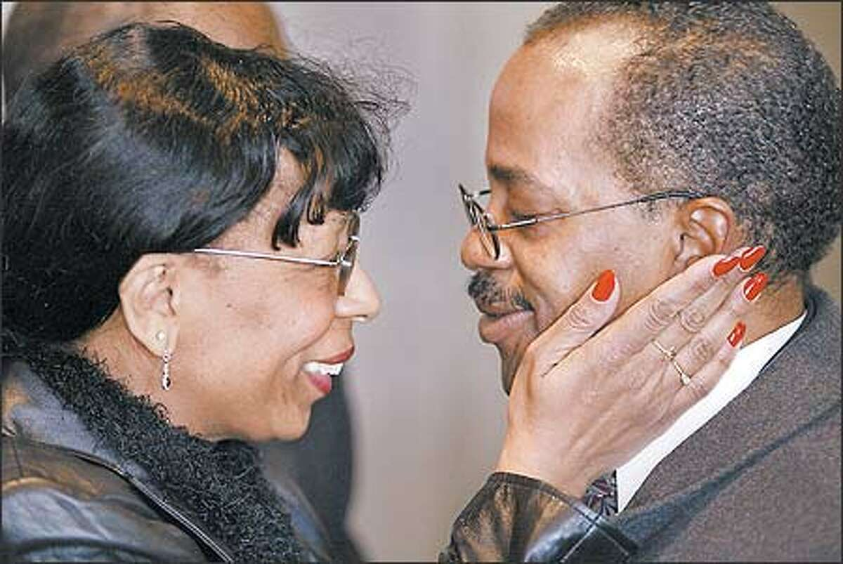 """""""I am here for you,"""" longtime friend Rhonda Wilkerson tells the Rev. Donald Ward during the memorial service for his son, Andrew. Pastors from a number of Seattle churches attended the memorial. Ward is pastor of Daystar Baptist Church in Renton."""