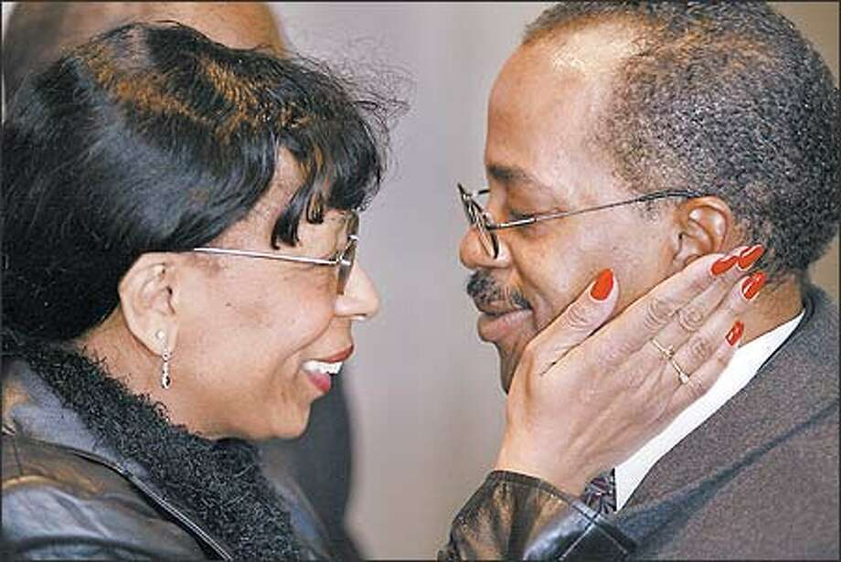 """I am here for you,"" longtime friend Rhonda Wilkerson tells the Rev. Donald Ward during the memorial service for his son, Andrew. Pastors from a number of Seattle churches attended the memorial. Ward is pastor of Daystar Baptist Church in Renton. Photo: Mike Urban, Seattle Post-Intelligencer / Seattle Post-Intelligencer"