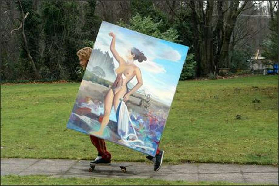 Adrien Miller skateboards down 29th Avenue East in the Madison Valley on his way home with a large painting. Miller said it was too big to fit in a car. Photo: Meryl Schenker, Seattle Post-Intelligencer / Seattle Post-Intelligencer