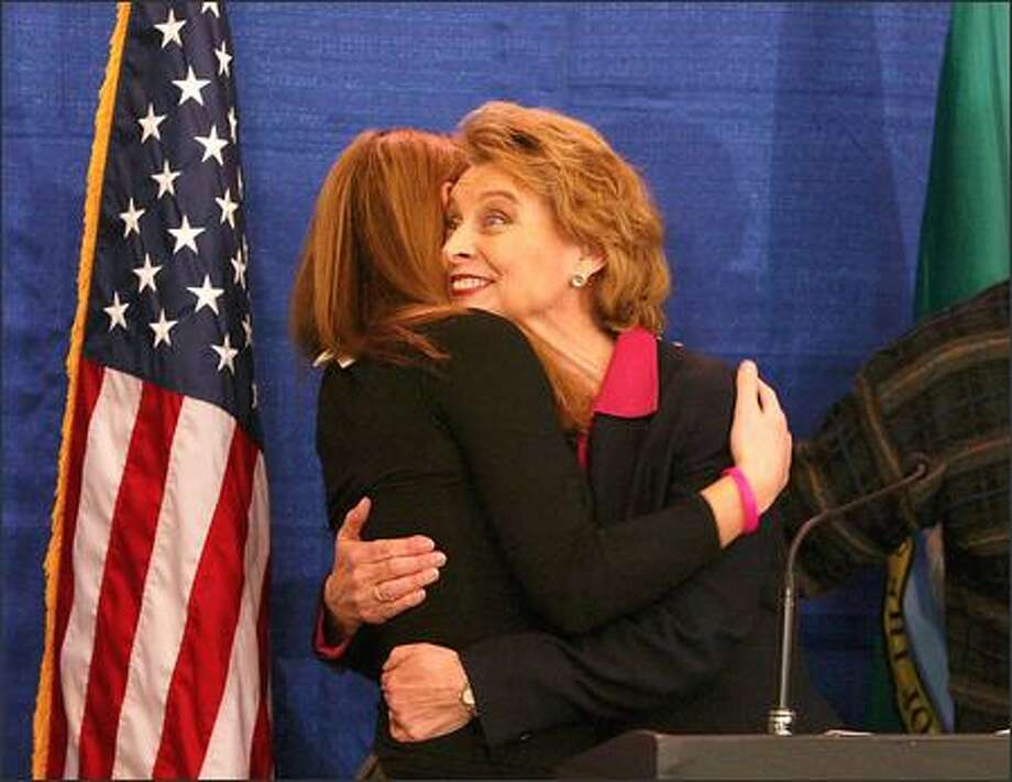 Gubernatorial candidate Christine Gregoire hugs her daughter, Michelle, in Seattle after the state Supreme Court ruled that 735 disputed King County ballots can be reviewed. Photo: Gilbert W. Arias, Seattle Post-Intelligencer / Seattle Post-Intelligencer